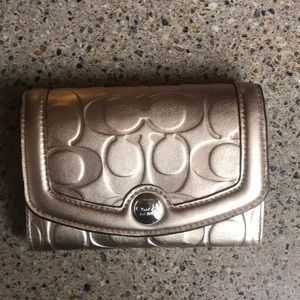 NWT Coach gold embossed wallet